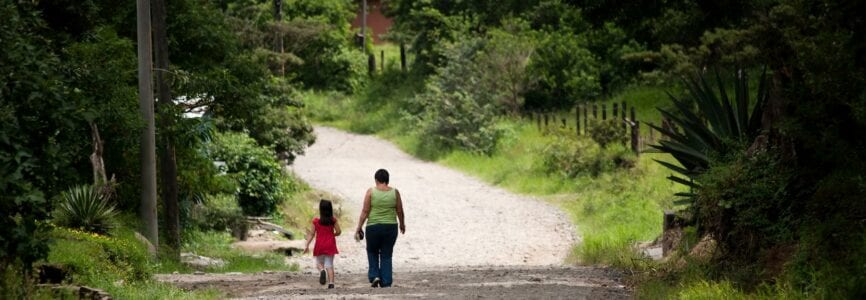 Woman and child walking in scenic Costa Rica