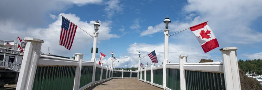 Roche Harbor - United States of America and Canada Flags Hang From the Dock