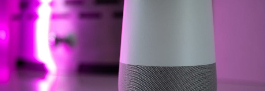 smart home speaker assistant on fireplace with led coloured ambient lighting - Pink