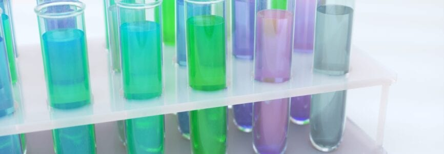 Many test tubes with colorful liquid of virus or coronavirus vaccine in research laboratory. Biological Threat Vaccine Ready. Learn for research