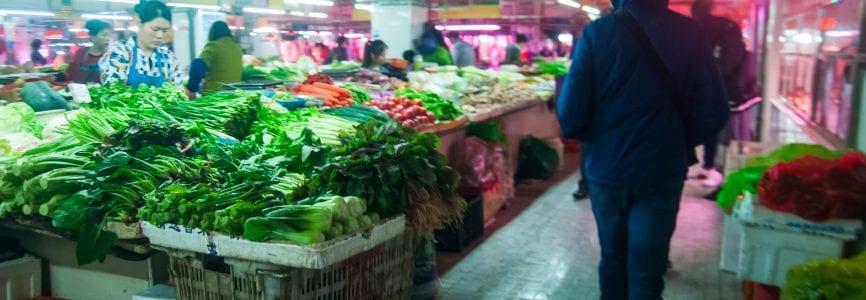 WUHAN,CHINA - April 4, 2019 - Market stand selling vegetables inside street food market.