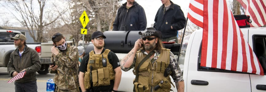 Helena, Montana - April 19, 2020: Yellowstone Militia of Billings, armed group of men carrying guns and weapons, protecting constitutional rights and freedoms at a rally at Montana's state capital.
