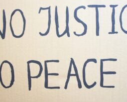 NO JUSTICE NO PEACE. Text message for protest on cardboard. Stop
