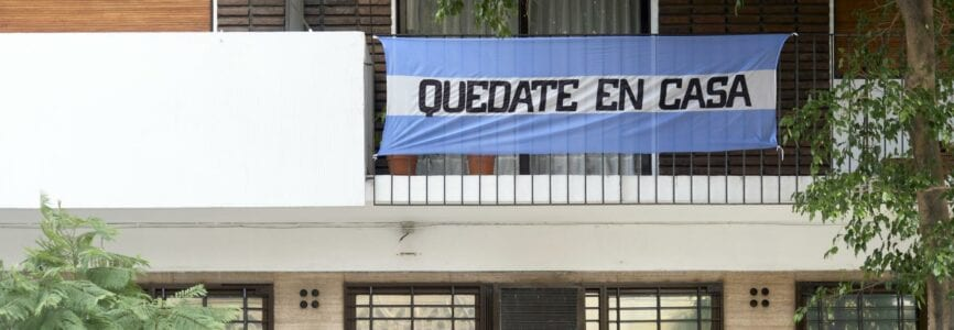 CABA, Buenos Aires / Argentina; June 28, 2020: Argentine flag with the message Stay at home, in the context of the pandemic and the quarantine to prevent the spread of coronavirus disease, Covid-19