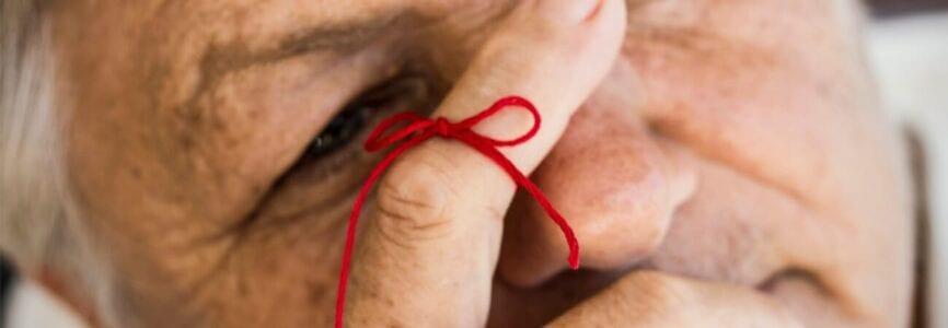 red string around finger