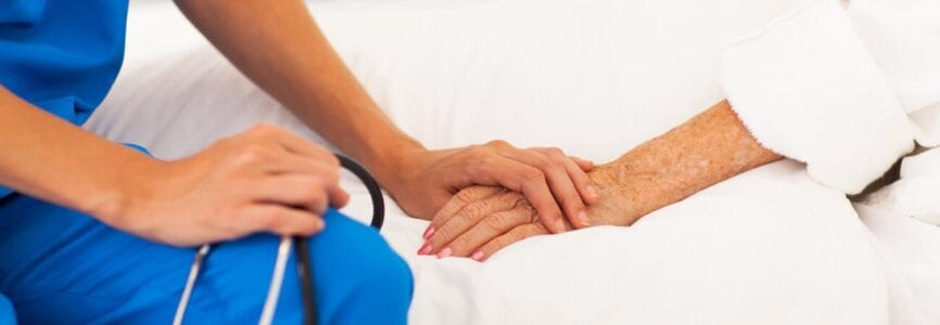 doctor holding patient hand