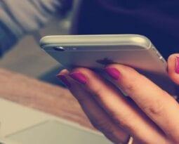 girl holding cellphone