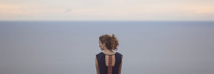 woman alone with horizon line