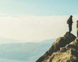 Couple summiting a mountain