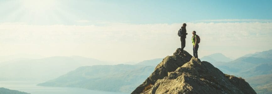Couple summiting a mountain