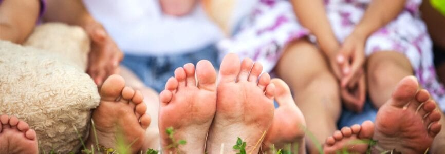 family sitting with feet towards camera