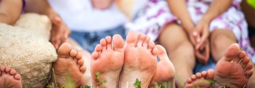 family sitting with feet towards camera
