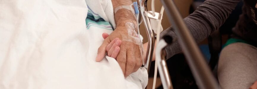 holding hands in hospital